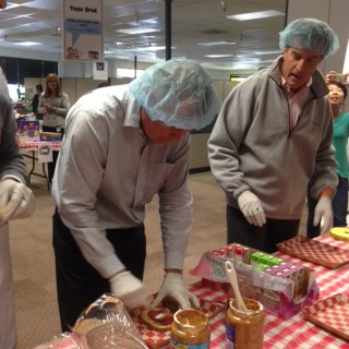President and Founder Dave Welch and VP Serge Melle face off in the Executive PB&J Event to see who can sell the most sandwiches to employees.