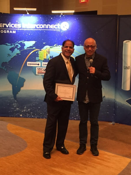 Infinera's Sharfuddin Syed accepts the certification at